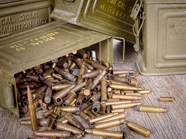 Ammunition Pouring Out Of Containers