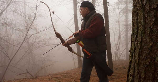 Bowhunter in Wilderness