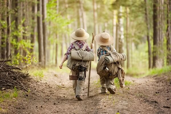 Boys in Forest With Backpacks
