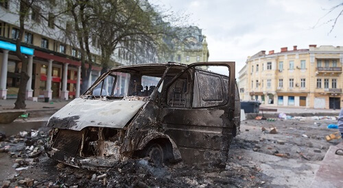 Burned Car after Civil Unrest | How To Defend Your Apartment From Looters After The SHTF