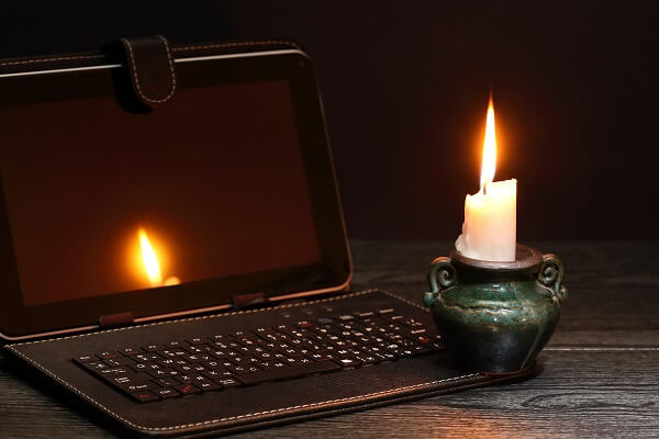 Candle by Laptop