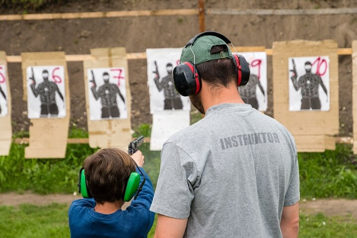 Child and Instructor at Shooting Range