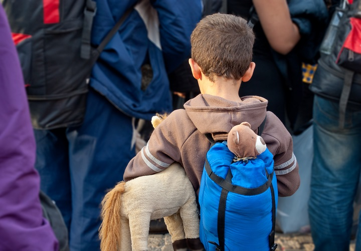 Child Refugee Carrying Toys