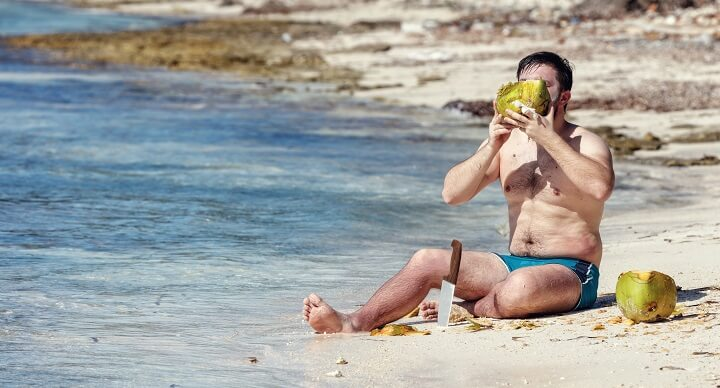 Desert Island Man Drinking Water