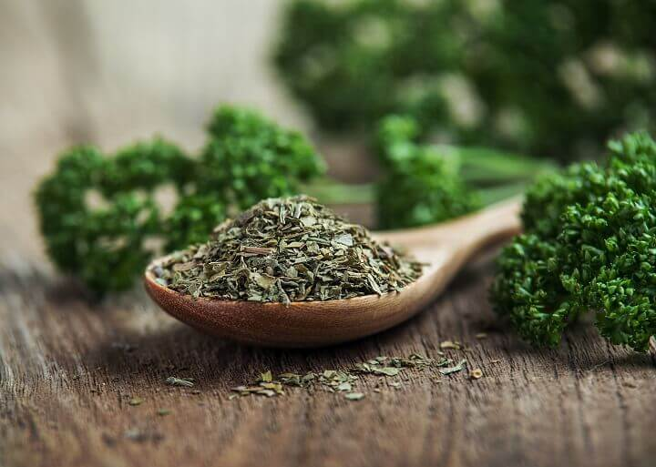 Dried Parsley On Wooden Spoon