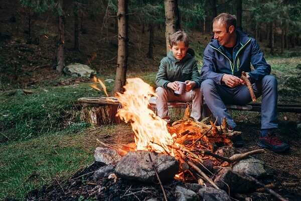 Father and Son by Campfire
