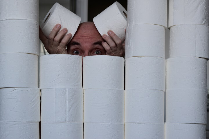 Guy Behind Wall Of Toilet Paper