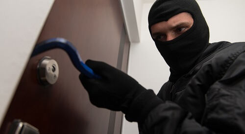 Looter Breaking Through Door How To Defend Your Apartment From Looters After The SHTF