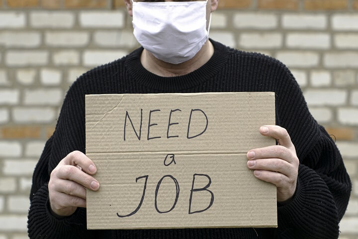 Man Holding Need-A-Job Sign