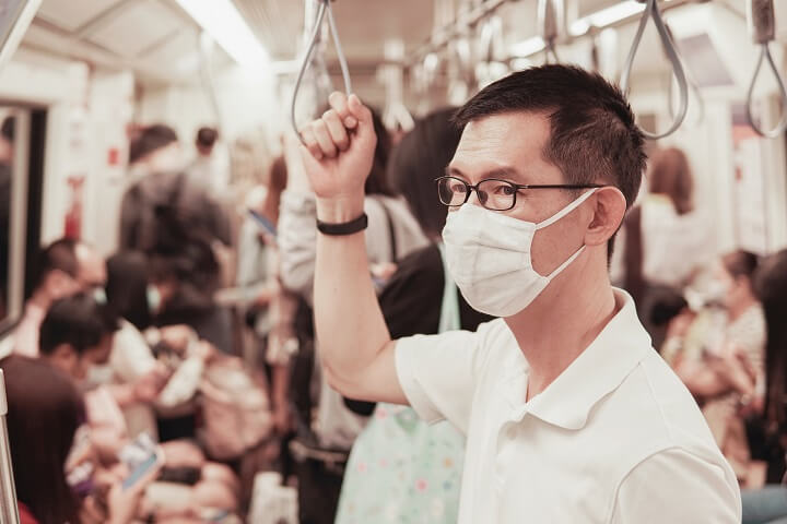 Man Wearing Flu Mask On Subway