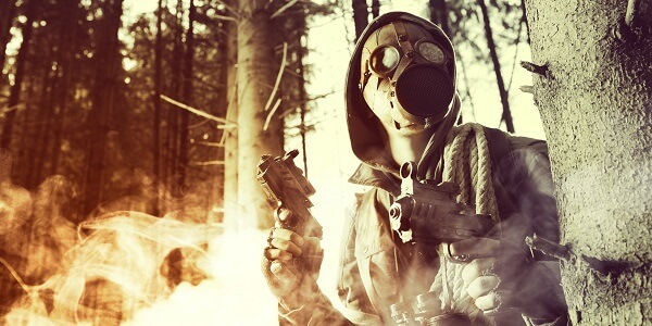Man With Survival Guns and Gas Mask