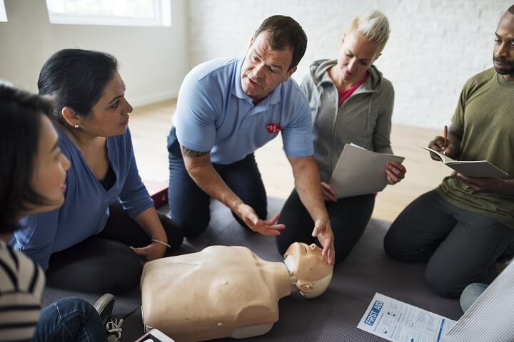 People Learning First Aid