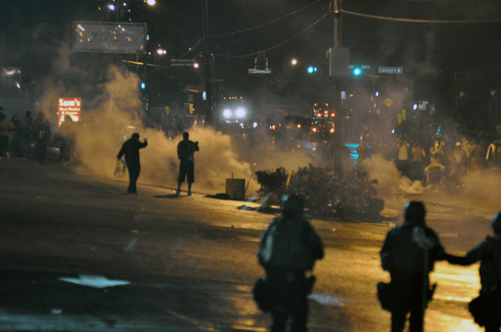 Police Tear Gas In Streets At Night