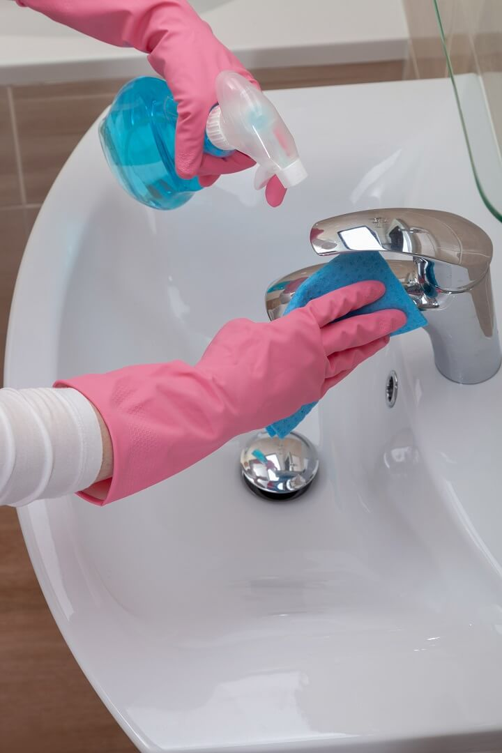 Rubber Gloves Cleaning Bathroom Sink
