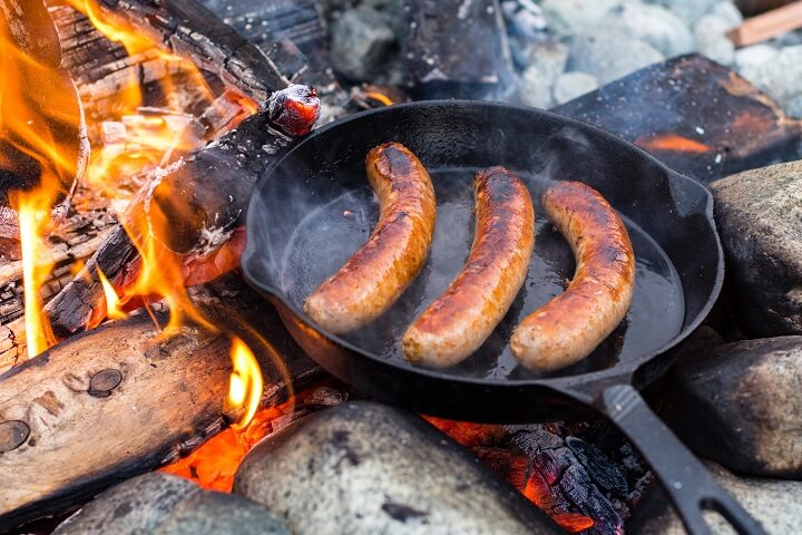 Sausage Cooking in Cast Iron Skillet