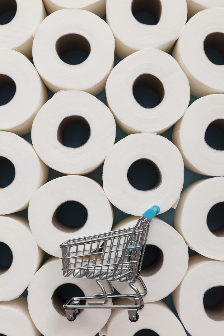 Shopping Cart in Front of Toilet Paper