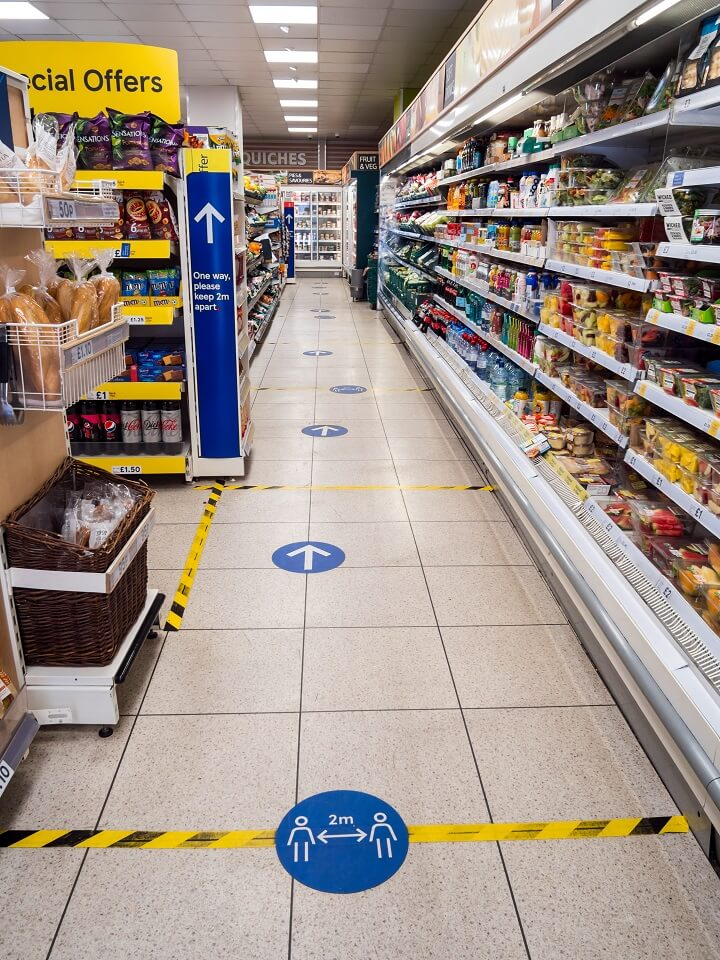 Social Distancing Signs In Grocery Store