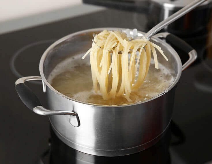 Spaghetti in Scoop over Boiling Water