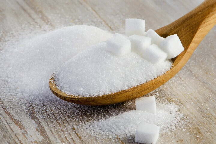 Sugar and Cubes in Spoon