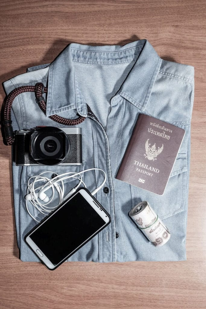 Travel Items On Folded Shirt