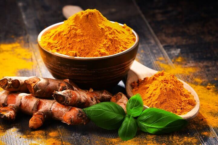 Turmeric in Bowl with Spoon