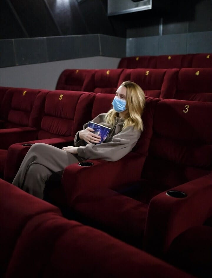 Young Woman Wearing Mask Alone In Theater